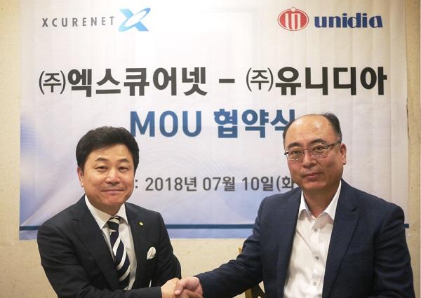 ▲ 엑스큐어넷-유니디아 협약식